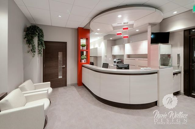 Dental reception desk- serene scheme with a sensory shock of red.  Click on our website link in our profile for more of our projects. #interiordesign #design #designer #customdesign #dental #reception #interiordesigner #dentaldesign #yyc #yycdesign #wallacedesign #spaceplanning #spaceplanner