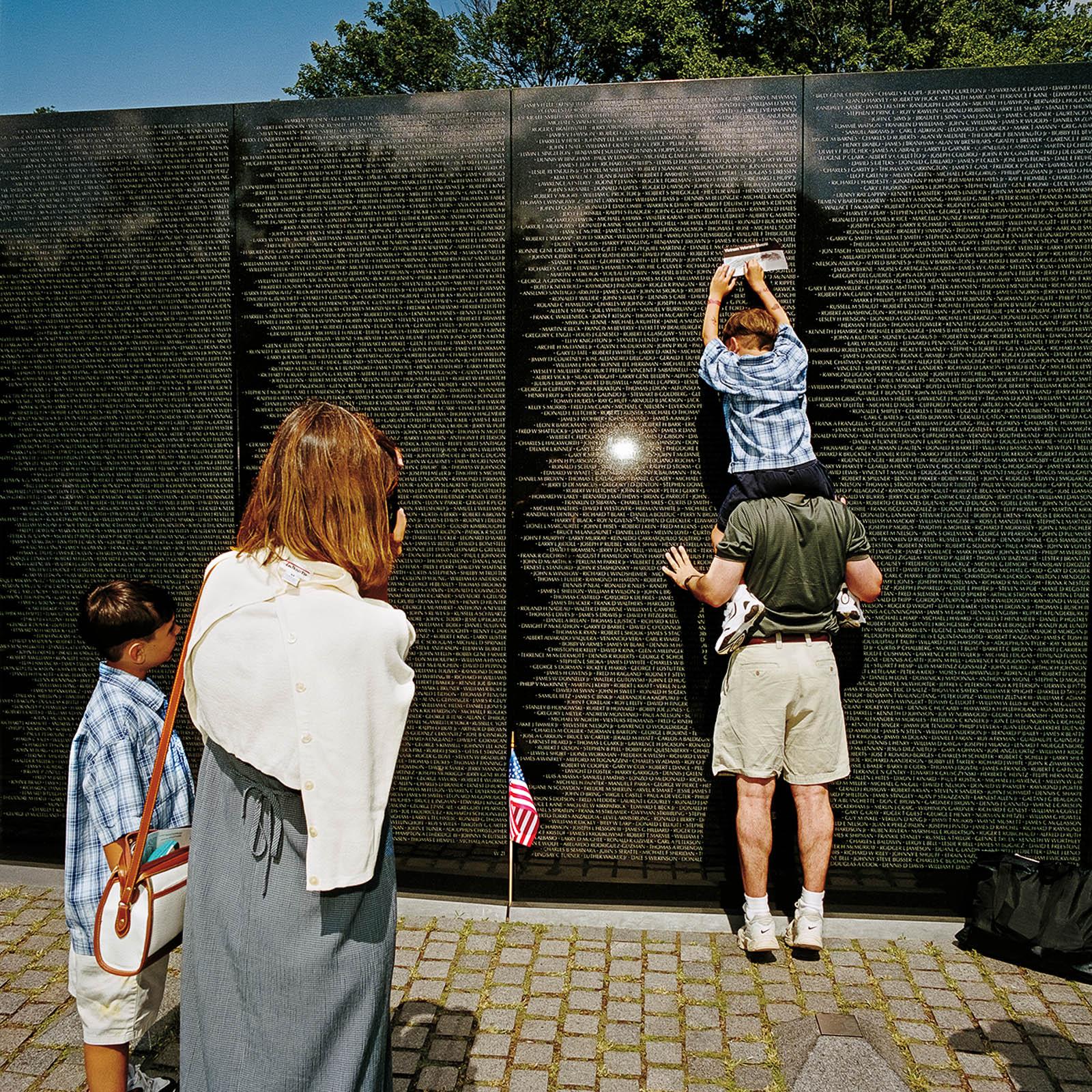 Family Taking Rubbing at Vietnam Memorial, Washington, DC 2000