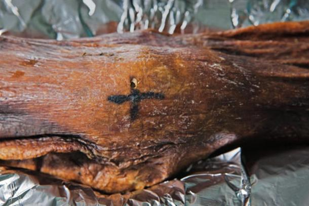 One of the tattoos found on Otzi the Iceman.