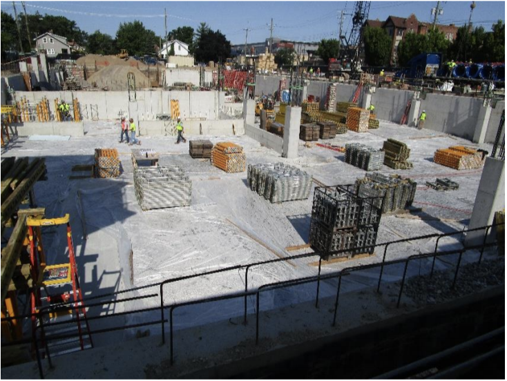 Slab on grade is covered in visqueen and forms are being installed in area A for first elevated slab.