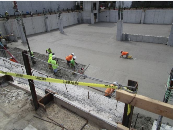 Concrete was being placed for slab on grade at area A (grids A-C and grids 10-14).