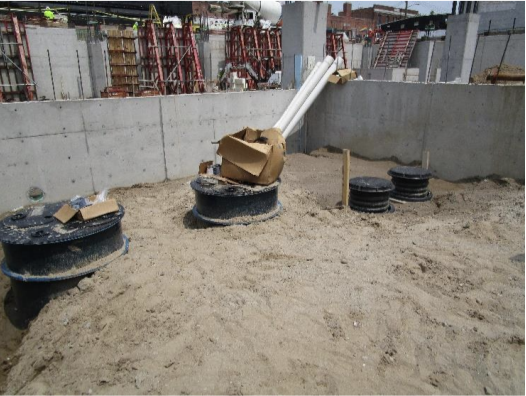 The sump pumps and sand oil separator were installed in the storage room south of grid B between grid 10 and 11.
