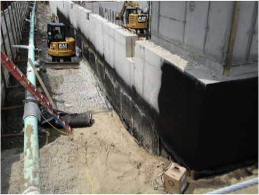 Waterproofing was being taken off the walls along grid C due to excessive heat and will be reapplied.