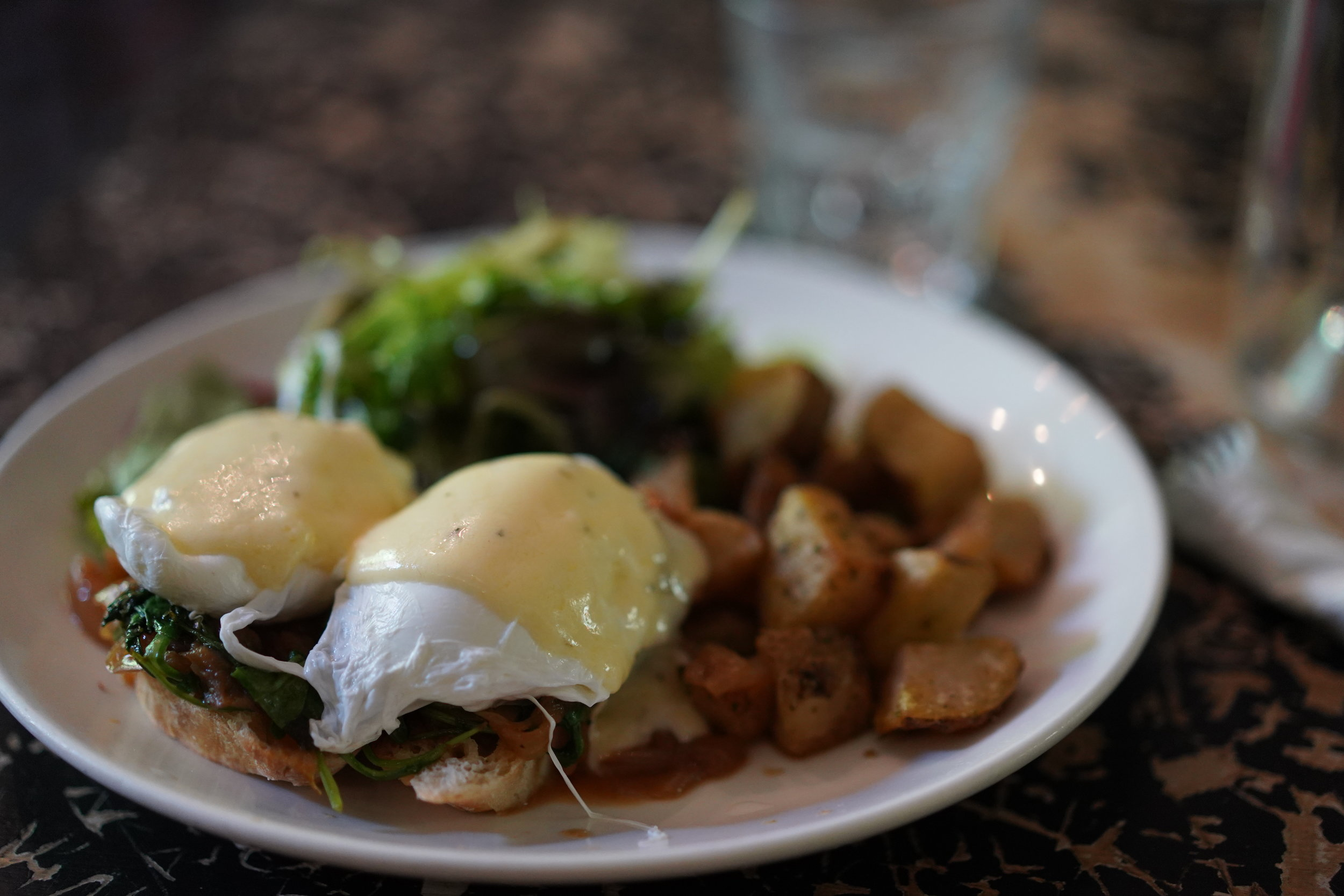 Rabbithole Florentine (served w/ potatoes & salad) $15 Poached eggs on wilted arugula, caramelized onion & sharp cheddar Mornay sauce on baguette