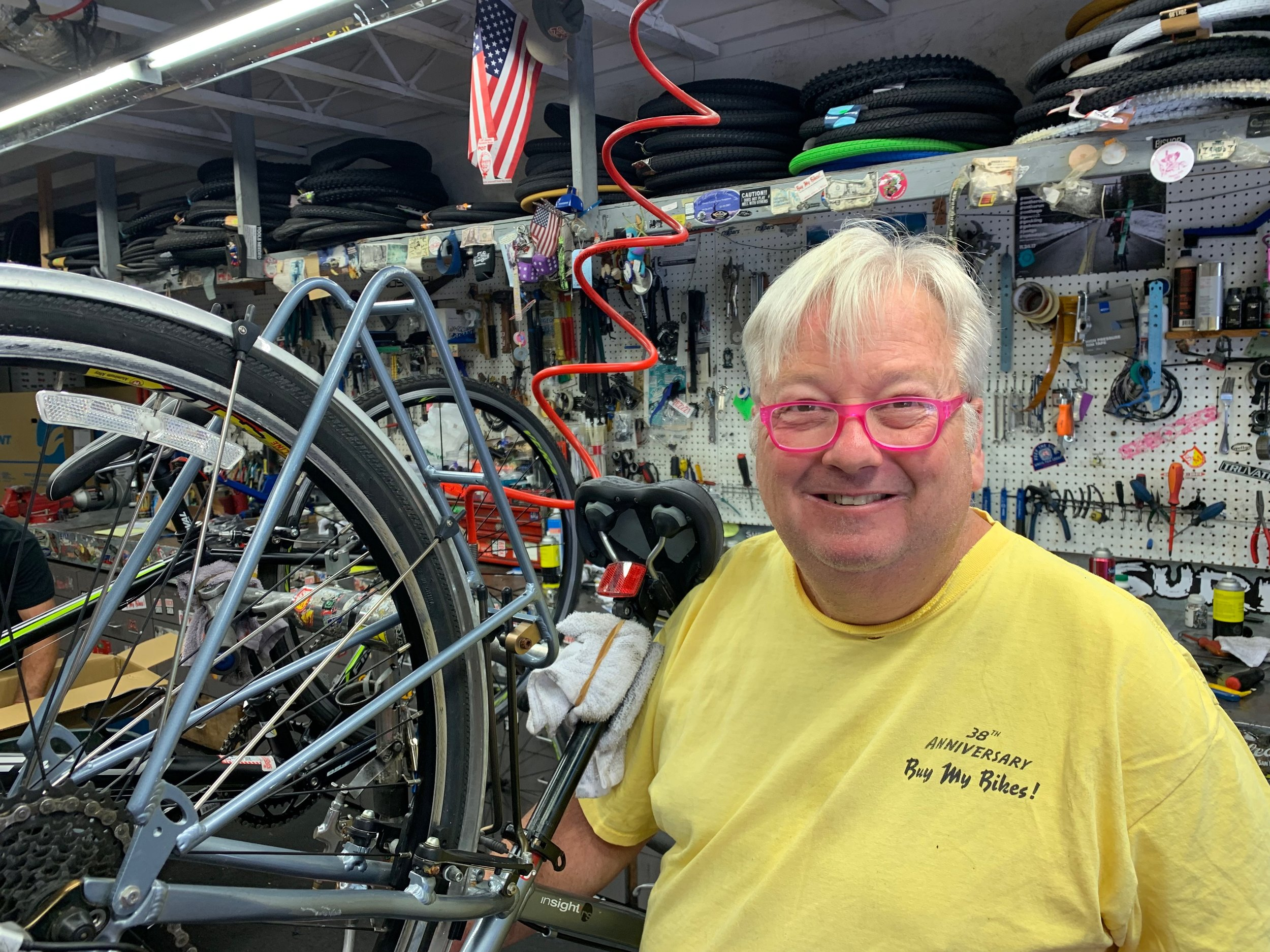 """Dave - Meet the man with patience and technical skill. 35 years ago Dave started working in a bike shop rather then his father's appliance repair shop. He never looked back and refuses to grow up. The culture within """"Buy My Bikes"""" allows him to be more comfortable and free with himself."""