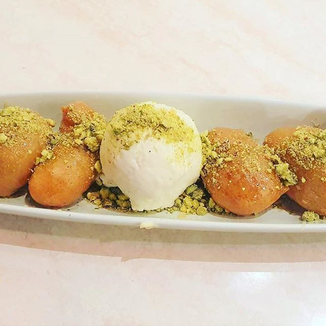 Need a sweet treat? Our Lokmades (greek donuts) are coated in a light honey syrup, dusted in pistachio nuts and served with ice cream.