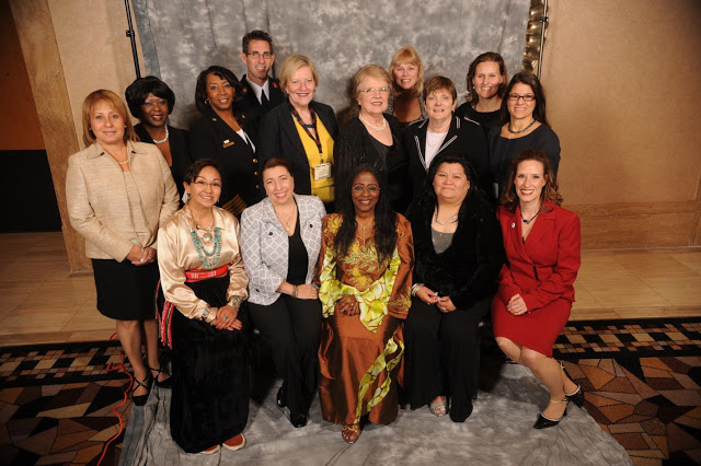 Searle (second from right, second row) was honored in 2011 at ceremonies in Las Vegas for the new Hall of Fame for Women in Homeland Security and Emergency Management. © 2011 inWEM