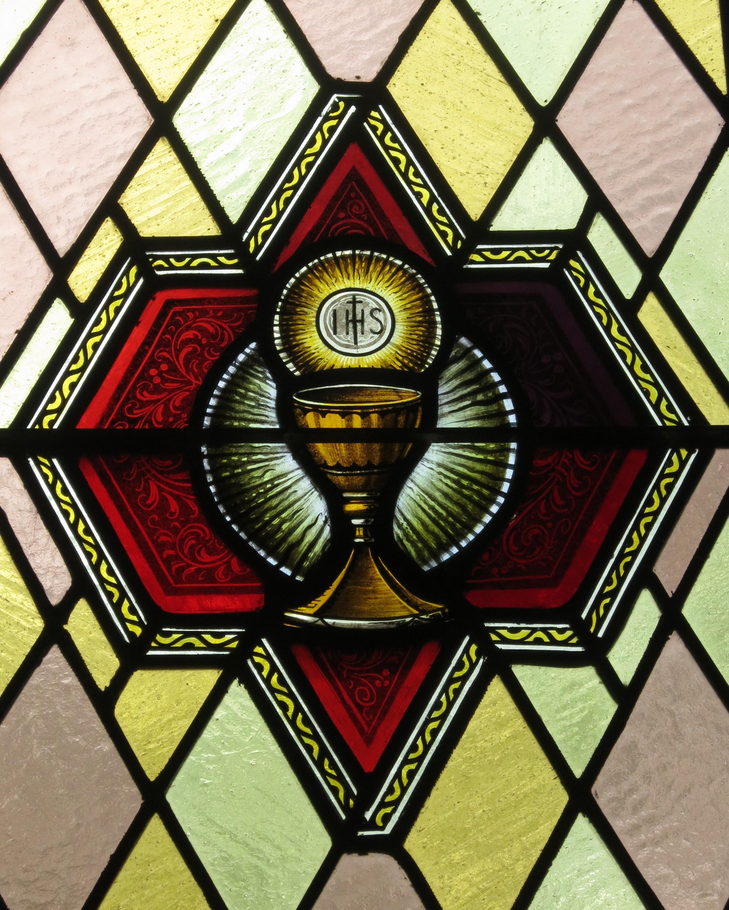 Immaculate_Conception_Catholic_Church_(Port_Clinton,_Ohio)_-_stained_glass,_Eucharist.jpg