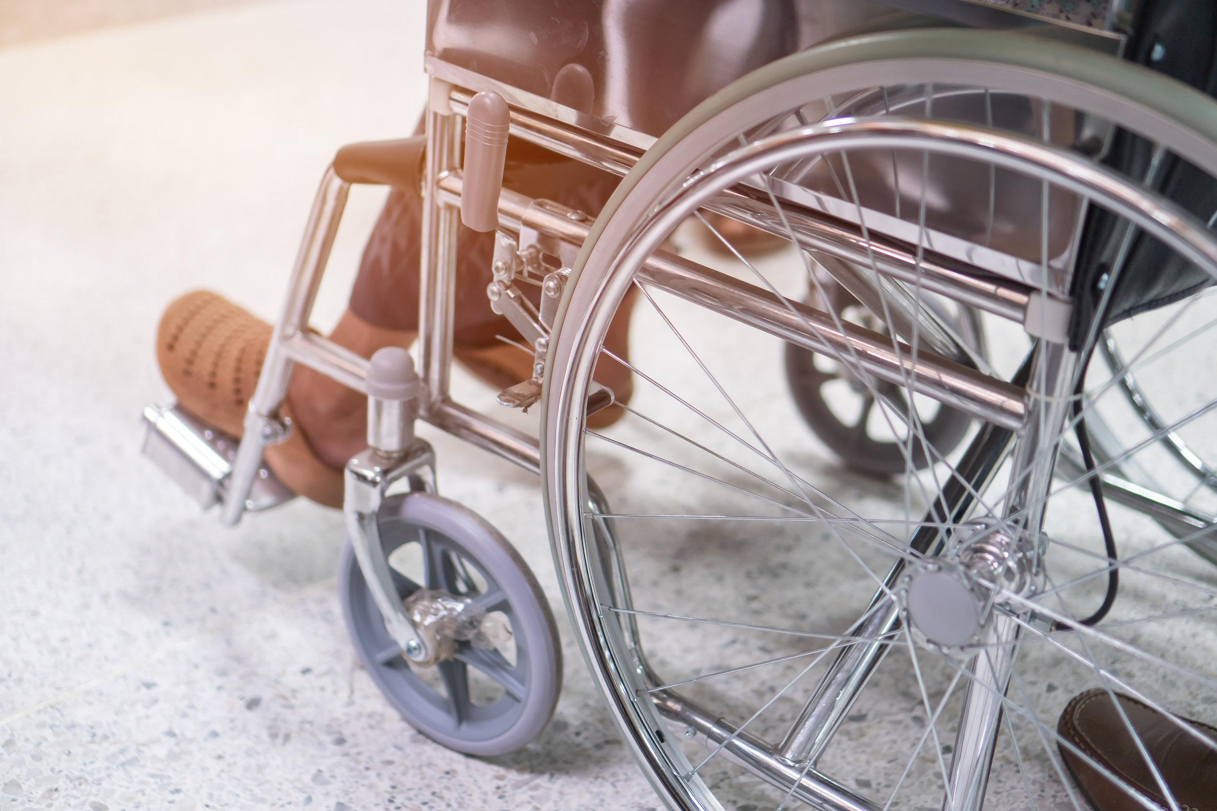 bigstock-Disabled-Older-Patient-Sitting-287398975.jpg