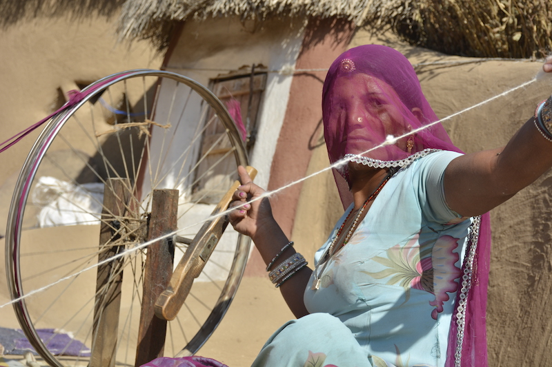 3. Spinning   After carding, the fibres of wool are twisted to form yarn. Traditionally, the women spin the wool fibers by hand using simple tools like the spinning wheel.