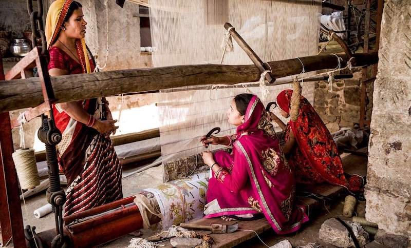 5. Weaving   The raw material is rolled to make balls so that weavers can easily tie knots. A graph of the carpet design will act as a guideline for the weaver, as it determines the position of each knot and colour.