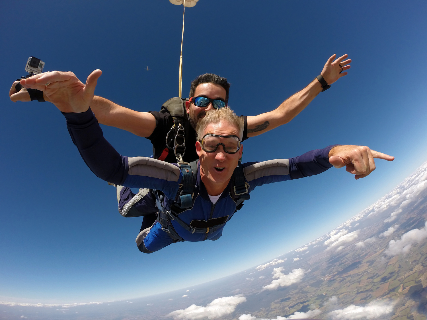 Happy middle-aged man doing a tandem skydive
