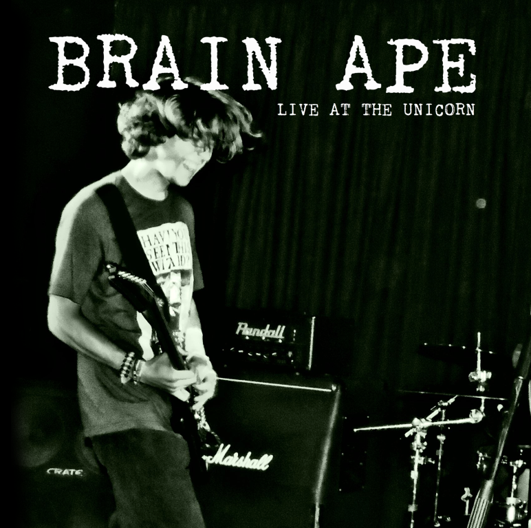 BRAIN APE: LIVE AT THE UNICORN - 'BRAIN APE: LIVE AT THE UNICORN' was the first physical video release by both BRAIN APE and SCRATCH ROCK RECORDS, and demonstrated the growth of both the band and the label. The DVD was launched on the 13th of December, where the band performed a release show at the Dublin Castle in Camden, London. The live video itself showcases the entirety of the band's July 2018 live performance at The Unicorn in Camden, and is still available as a physical disc containing four panels of artwork, photographs of the band during the performance, and liner notes.