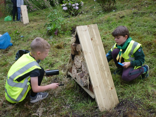 Cubs helping to increase wildlife diversity at Goostrey station by building a bug hotel.jpg