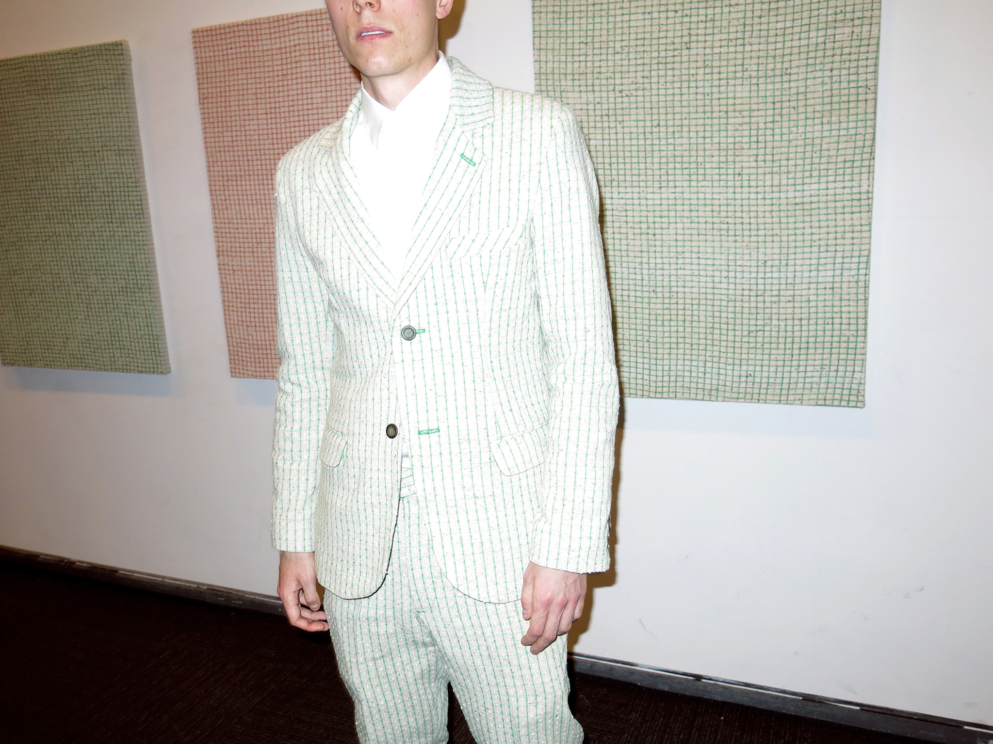 The artist in 2013 wearing a suit tailored to match his paintings.