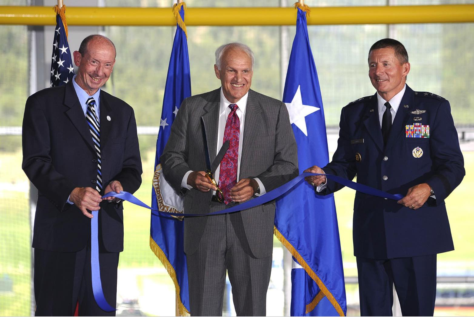Ribbon cutting ceremony for the Holaday Athletic Center, Bart Holaday (center)