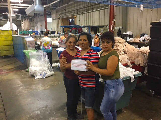 White Plains Linen employees gathering donations for hurricane Harvey victims.