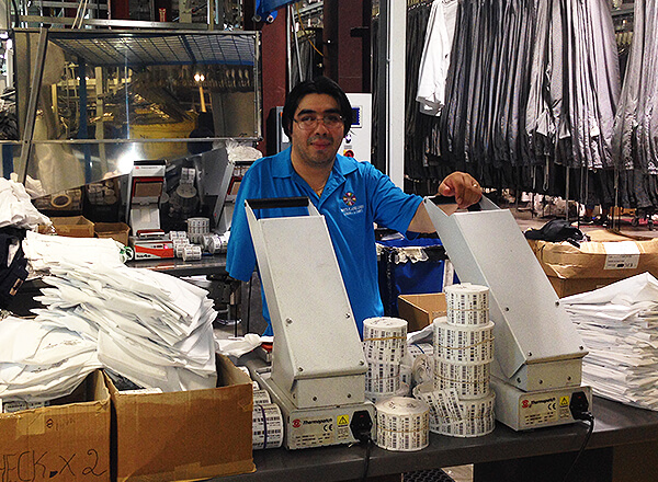 Henry Contreras Torres works full-time as a Floor Man responsible for affixing appropriate bar code tags to garments at White Plains Linen