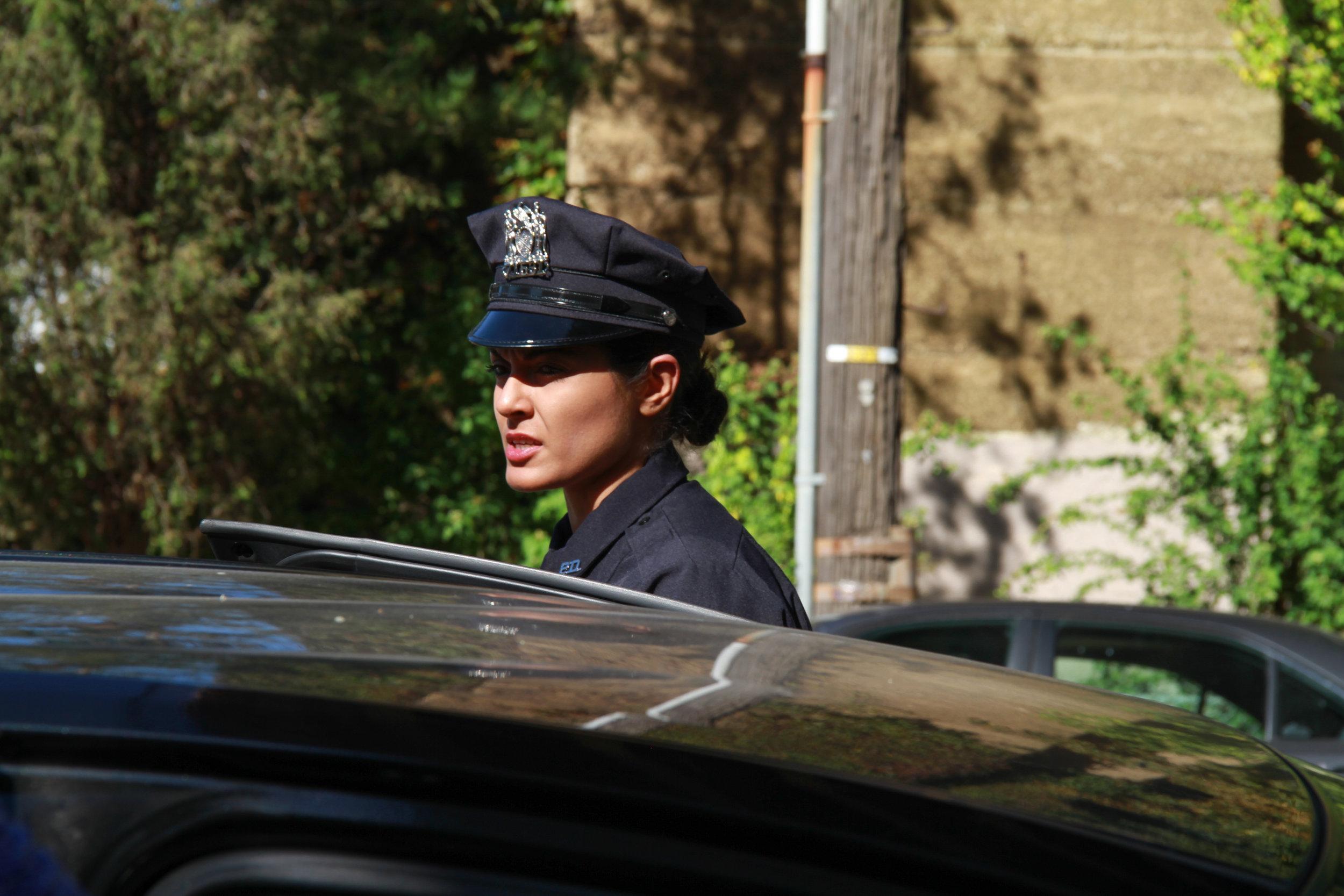 Qurrat Kadwani as Officer Mack