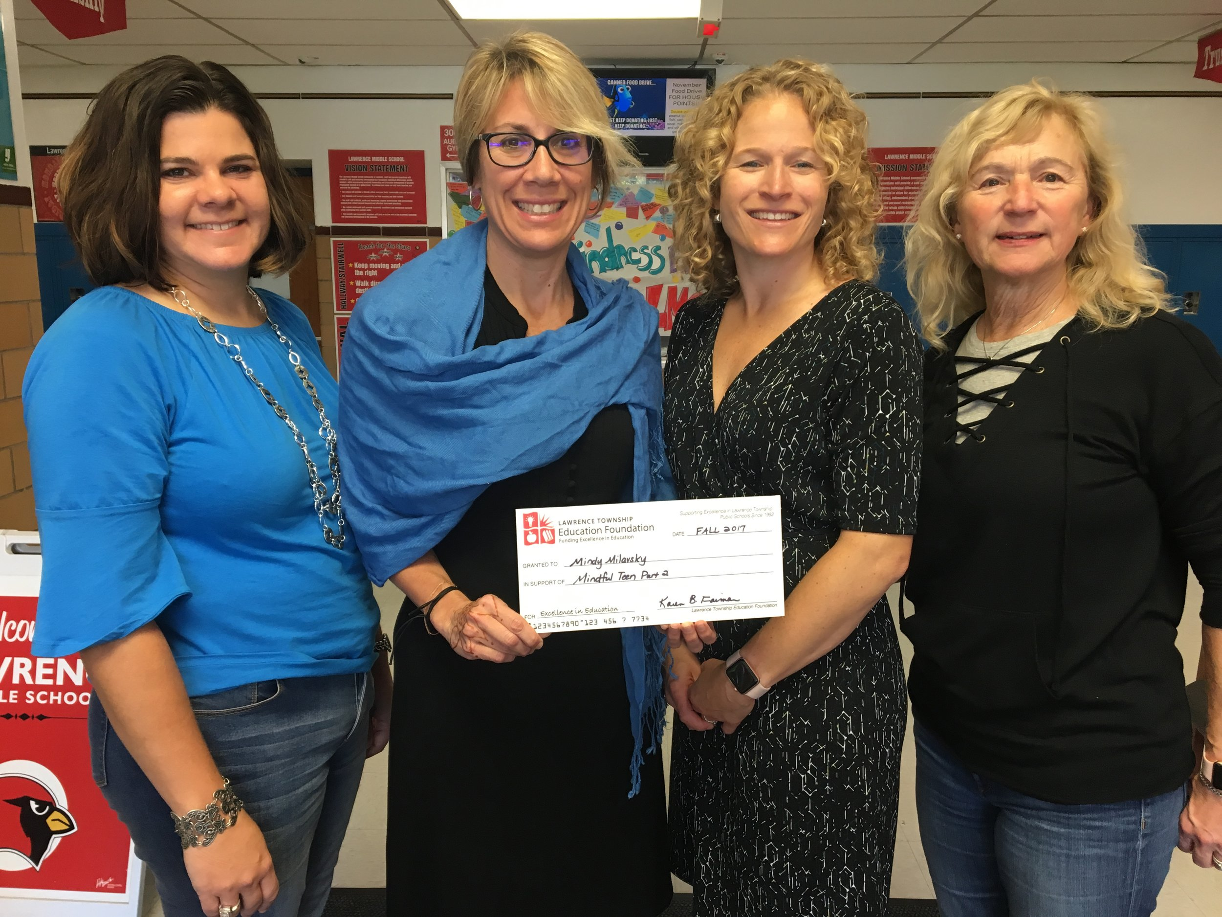 From left to Right: Amy Davis, LTEF Board President; Mindy Milavsky, LMS Principal; Karen Faiman, LTEF Executive Director; JoAnn Groeger, LTPS Board of Education.