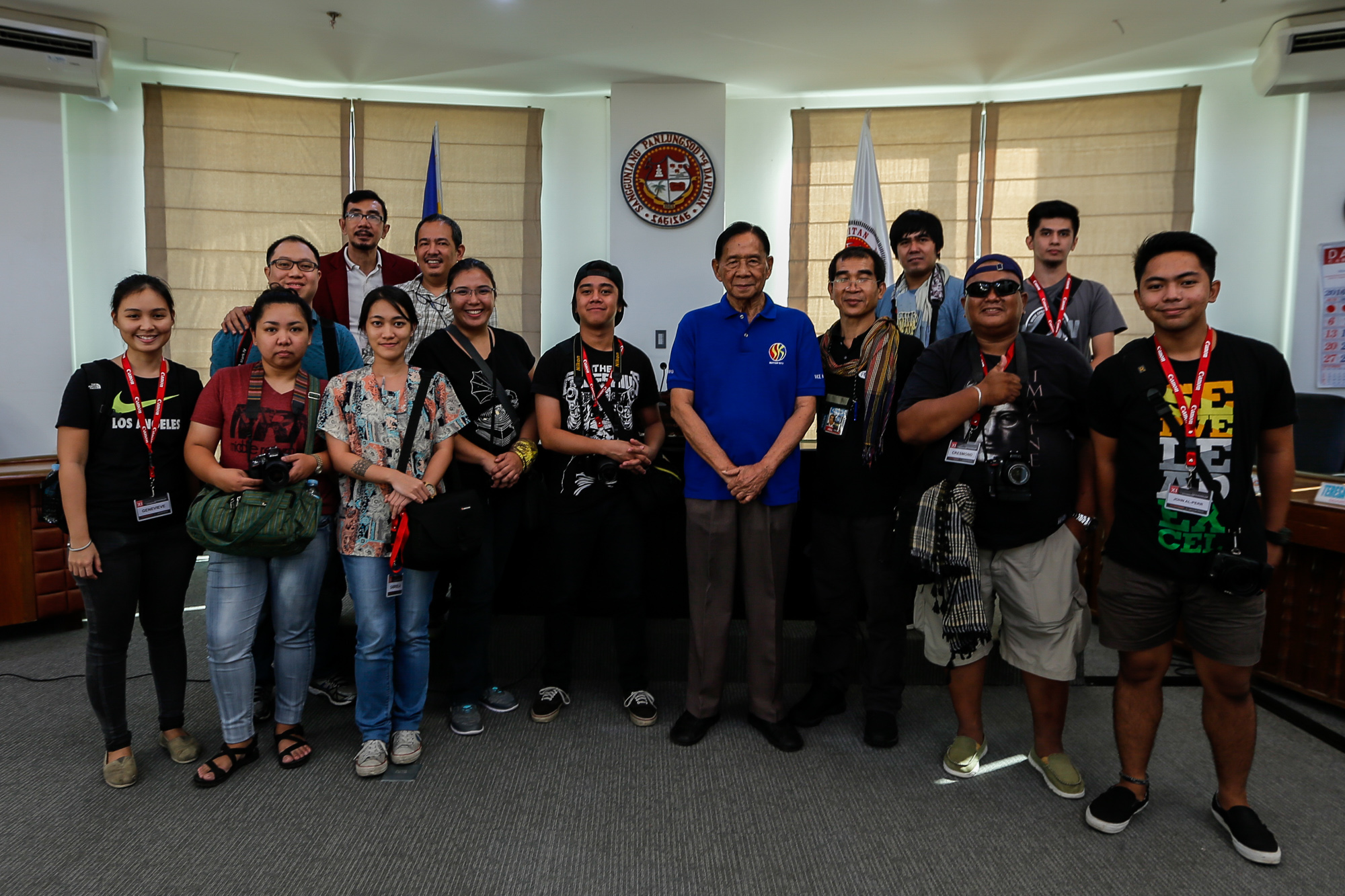 Dapitan city Vice-Mayor Ruben E. Cad (middle, in blue shirt), officers and members of the Photojournalists' Center of the Philippines, and participants of the 11th Professional Photojournalism and Documentary Photography workshop pose for the camera after a meeting on November 22, 2016.