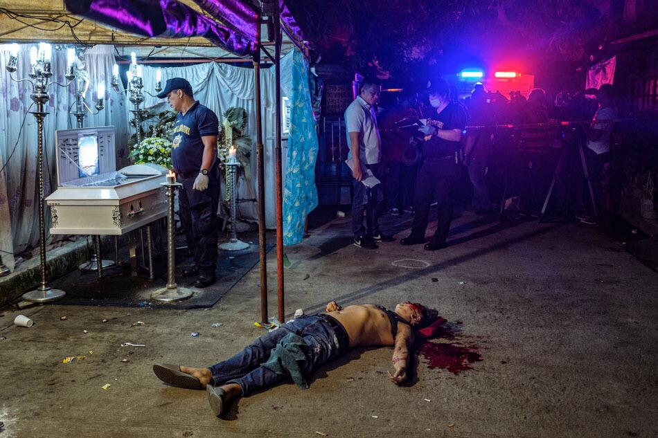 The body of Michael Nadayao lies in the street after he was shot dead by unidentified men in front of mourners at a wake, in Quezon City, Philippines, on August 31, 2018. Ezra Acayan, World Press Photo
