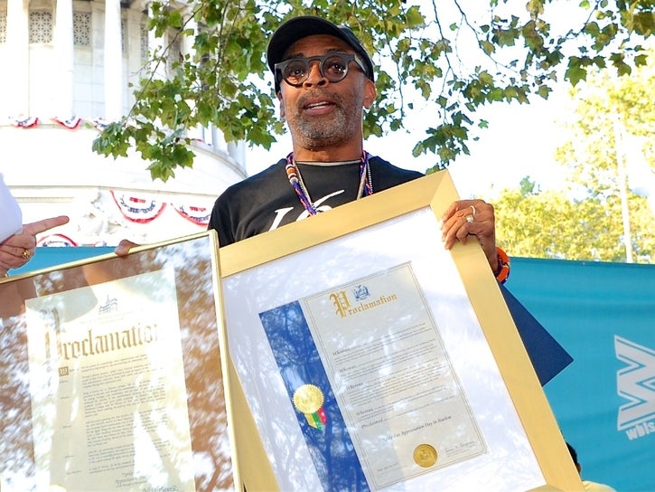 Spike Lee poses with proclamations. (Nadezda Tavodova Tezgor)