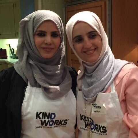 Noor and Basma, for whom KindWorks set up apartments, teach a Syrian cooking class.