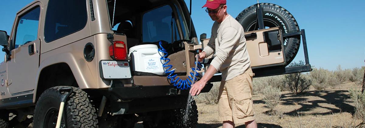 8 Gallon Big Kahuna Portable Shower in the California high desert