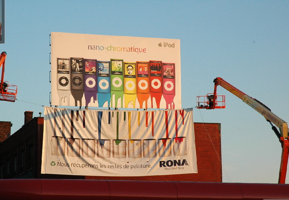 "In Montreal, a home depot type store called Rona created this clever banner to go beneath our billboard. It translates to ""we recycle leftover paint."" Well done, my friends."
