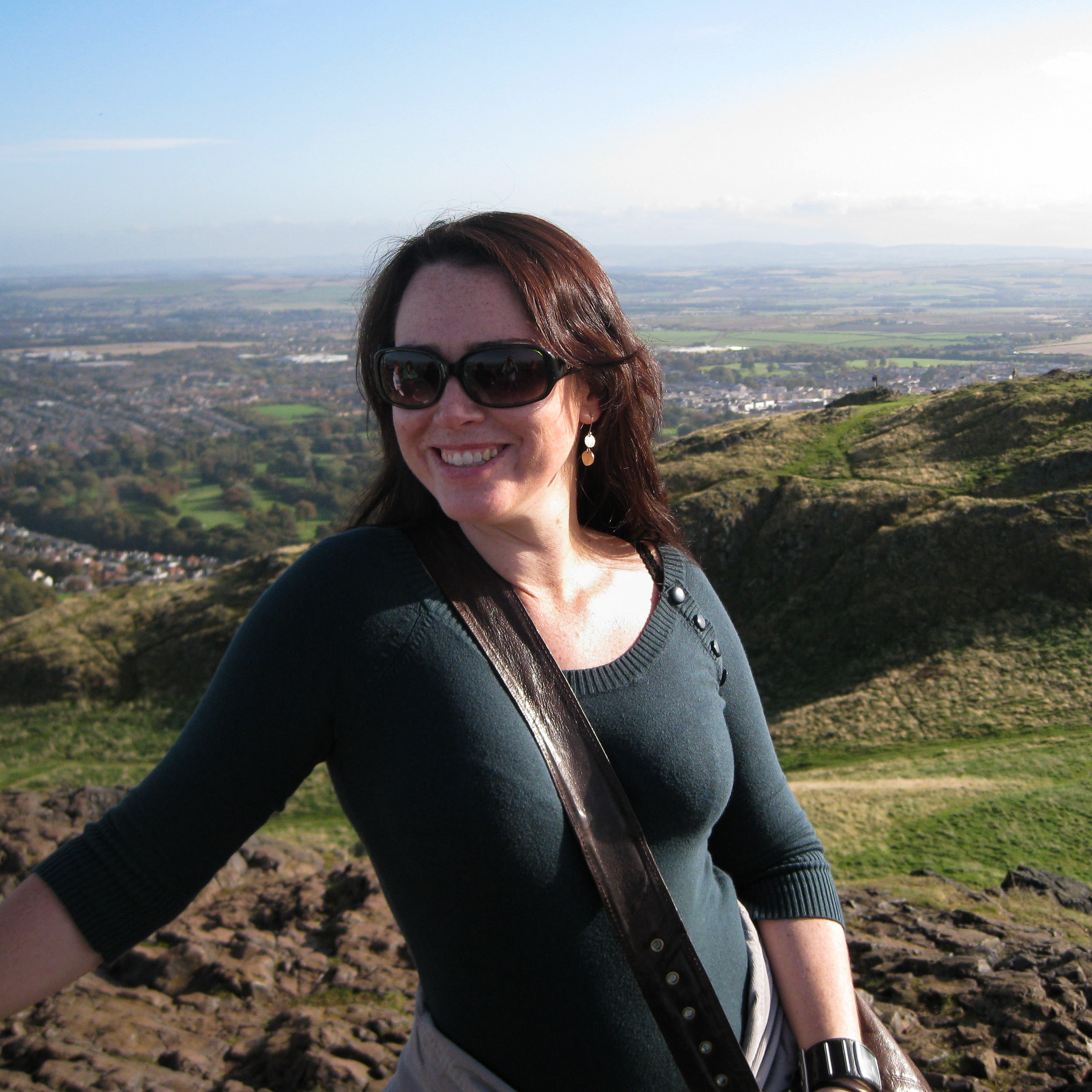 Woman poses for photograph on top of Arthurs Seat