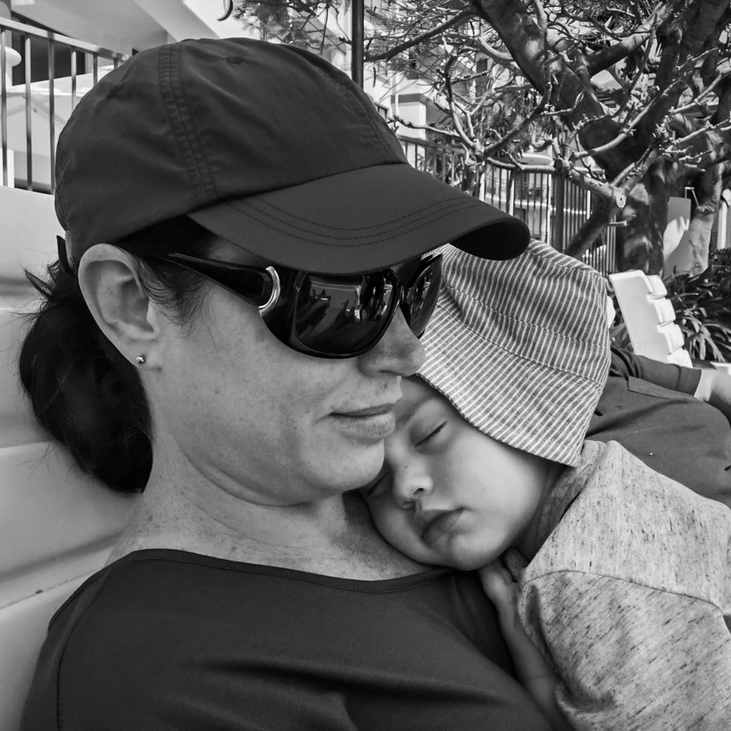 Little boy asleep and resting on woman