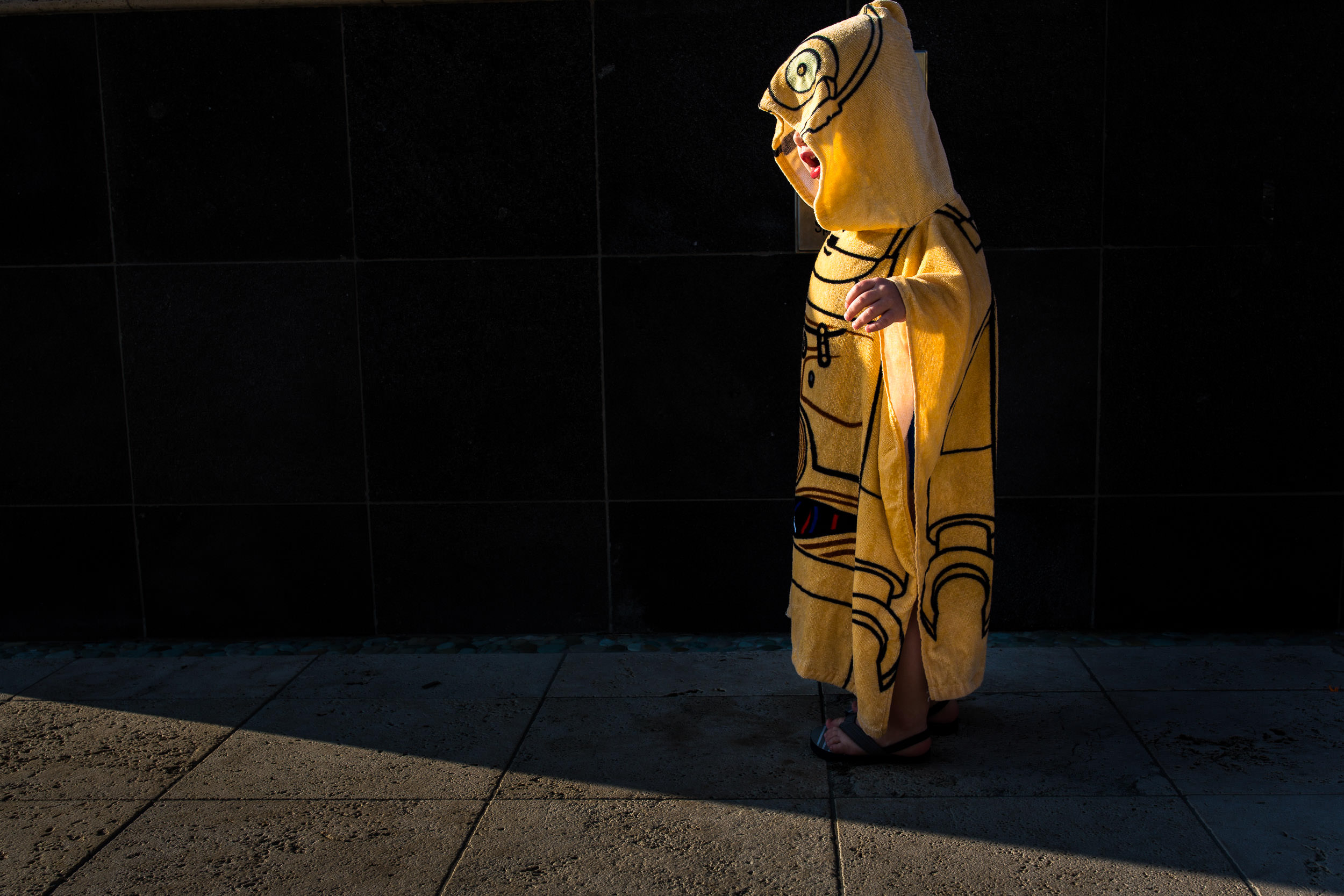 Boy dressed in a C-3PO hooded towel
