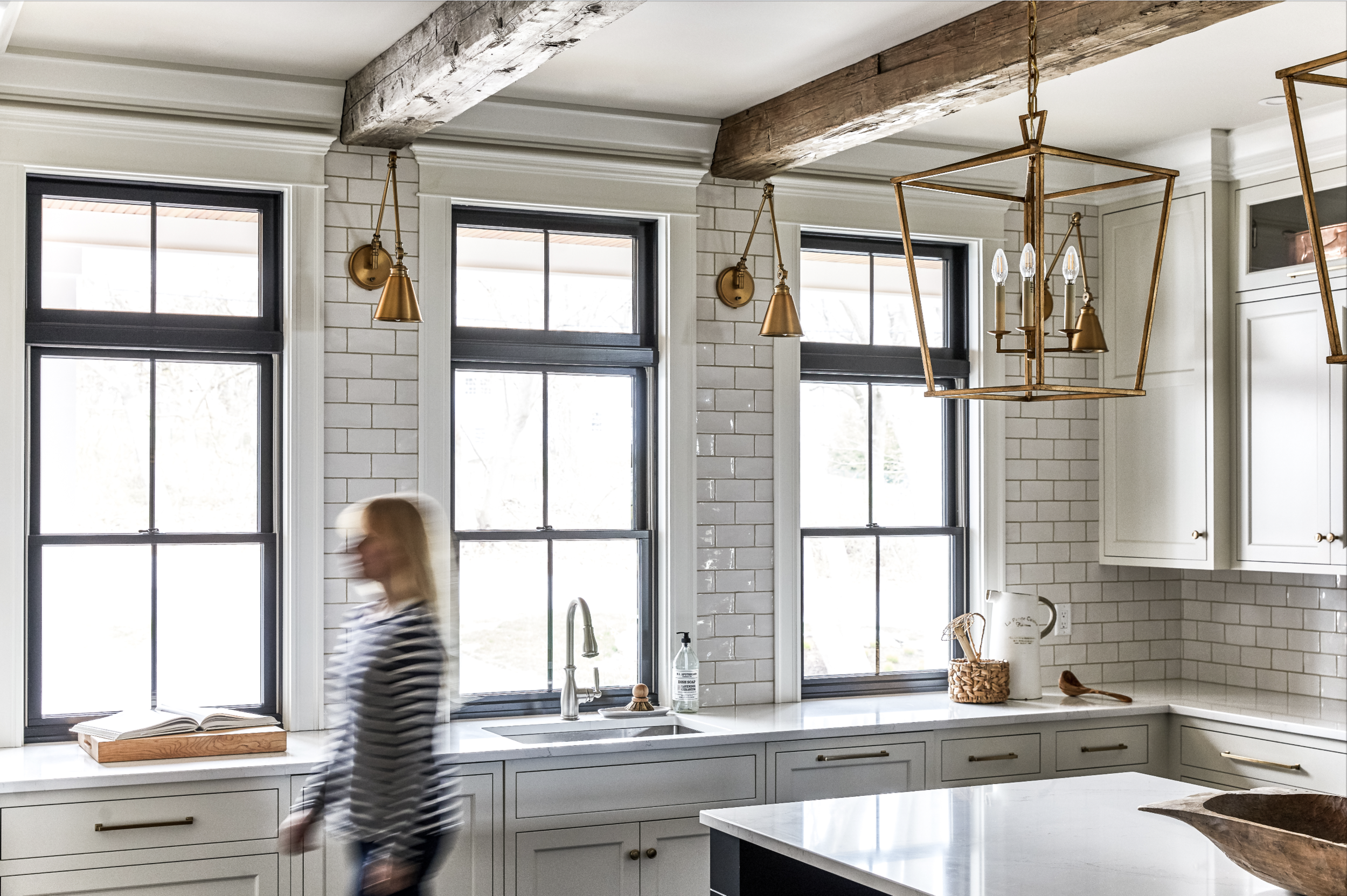 TRUNDY POINT - This newly built home's timeless feel reflects days gone by. Velvety painted cabinetry and polished calacatta quartz countertops are mixed with reclaimed barn beams, antiqued brass light fixtures and handmade tile to create layers of rich texture. Deceptively simple, the creamy white kitchen with striking blue island and separate butlers pantry, provide all the luxury and innovation of a well appointed custom home.