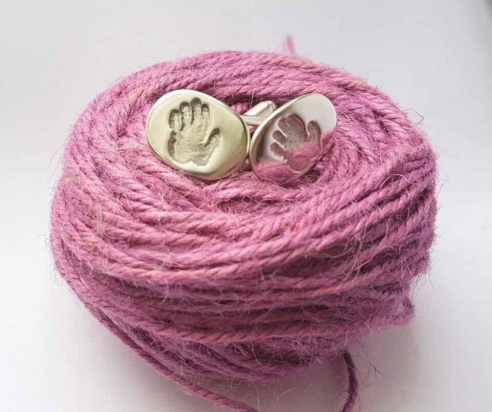 BPP silver handprint sufflinks on wool.jpg