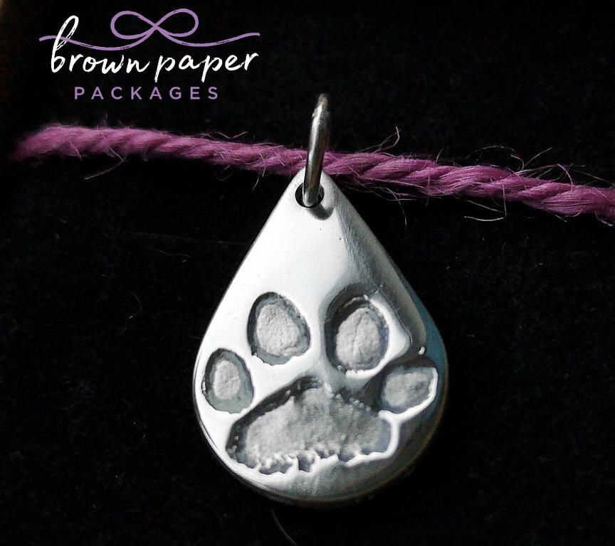 BPP silver paw print pendant tear drop.jpg