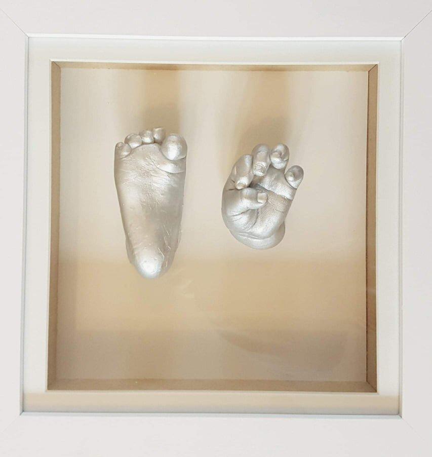 cast hand and feet framed 2.jpg