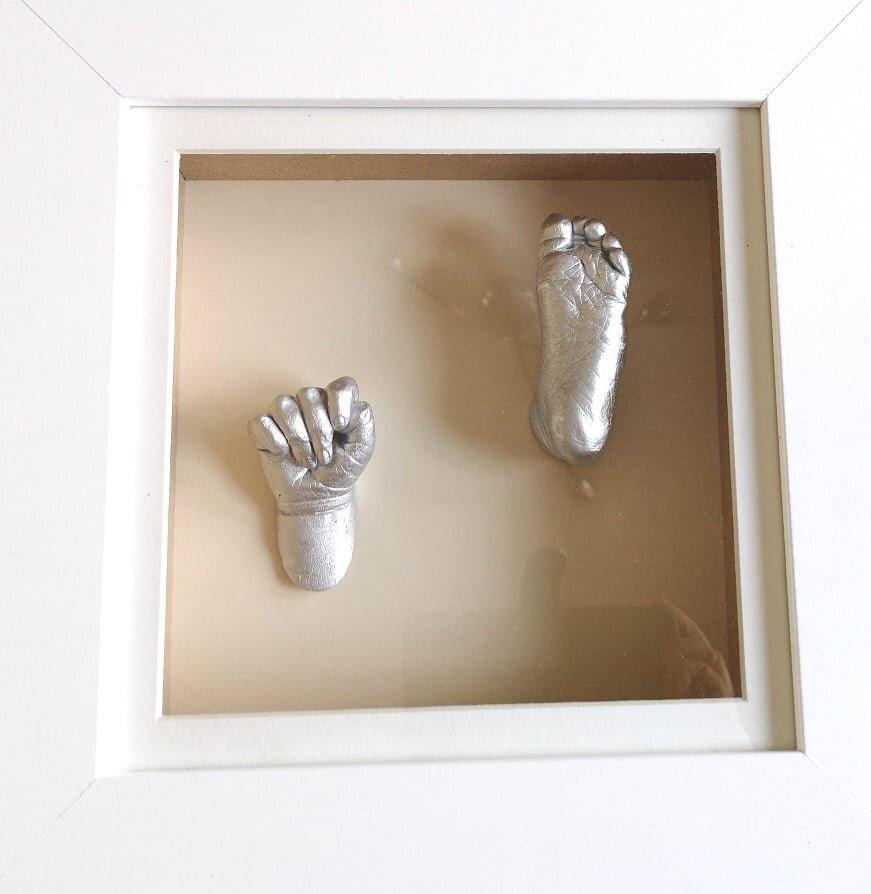 cast hand and feet framed.jpg