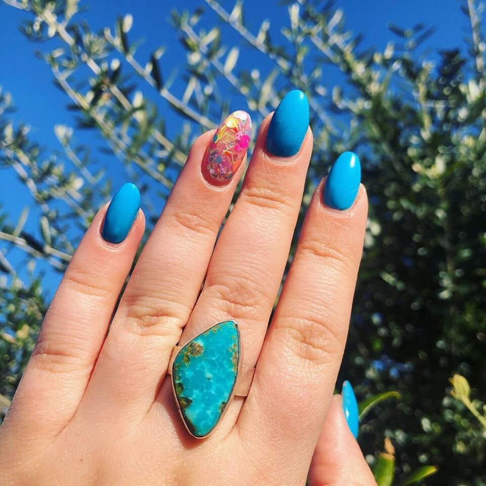 Turquoise ring on hand.jpg