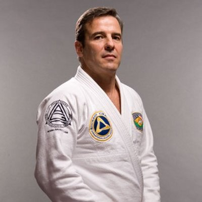 Pedro Sauer - Pedro Sauer was born and raised in Rio de Janeiro, Brazil, where from an early age, he began training in the martial arts. At age five, he began boxing and later took up judo and taekwondo. At age 15, however, his friend Rickson Gracie, invited him to train jiu-jitsu with his younger brother, Royler, who at the time was only nine years old. The outcome of this experience convinced him that jiu-jitsu was the most effective of all the martial arts, and he began training the very next day.His training under both Helio and Rickson took place during a time when jiu-jitsu was making its crucial transition as an obscure Brazilian art to a worldwide martial arts phenomenon. He worked in Brazil as a stockbroker for eleven years before deciding to move to the United States and pursue a career teaching jiu-jitsu. With Rorion Gracie leading the exodus in 1990, Pedro was part of the first generation of Brazilian Jiu-Jitsu instructors and fighters that moved to the United States to reveal the art of BJJ to the world. He lived in California with Rickson Gracie and trained daily with the Gracie brothers (Rickson, Rorion, and Royce), their father, Helio Gracie, their cousin, Renzo Gracie and the Machado Brothers, as well as many others. In December of that same year, he moved to Utah where he began pioneering Gracie jiu-jitsu in the American southwest and eventually started the Pedro Sauer Brazilian Jiu-Jitsu Association, which is now one of the largest and most respected Gracie Jiu-Jitsu Associations in the world today with well over 100 academies under his guidance.In 2006 Master Sauer relocated to Northern Virginia to set up the world headquarters for the PSBJJA in Herndon, Virginia.