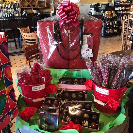 gifts &gift baskets… - How could Sun Singer be even more fun ? Add an ever changing selection of hand-picked gifts and custom designed gift baskets with something unique tucked in every corner of the store. That's how! Sun Singer is truly an Adult Candy Store all the way to our Gift Department. With the wine lover always in mind, we fill our shelves with everything that compliments the wine lifestyle - from glassware to wine aerators, bottle stoppers to wine toting handbags! If you are looking for a gift for the novice or the connoisseur, there's no need to look any further.