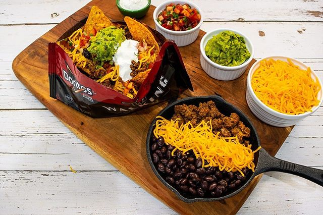 Transform a bag of Doritos into loaded nachos, starring guac, sour cream, ground beef, and more. Introducing our new Build-Your-Own Nachos. 🎉