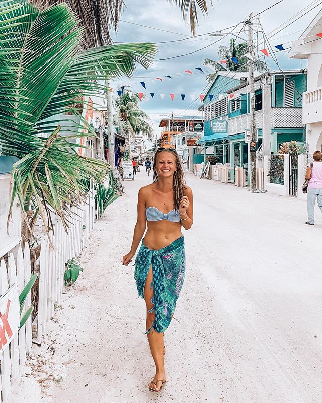 """my new #wanderlustandwifi life has no time for throwbacks so you all are just gonna have to deal with real-time insta spam. ☺️ ⟡ Caye Caulker is the cutest little island paradise a 45 min ferry from Belize City. the buildings are colourful and adorable, ocean water is bathtub warm (like not refreshing), and barefoot is the go-to footwear. there's fresh $5 lobster being grilled on the street, no motorized vehicles, and the motto is """"Go Slow."""" it reminds me of Indo's Gili islands or Brazil's Ilha Grande, but so far seems to have a little extra touch from the universe ✨✨💙"""