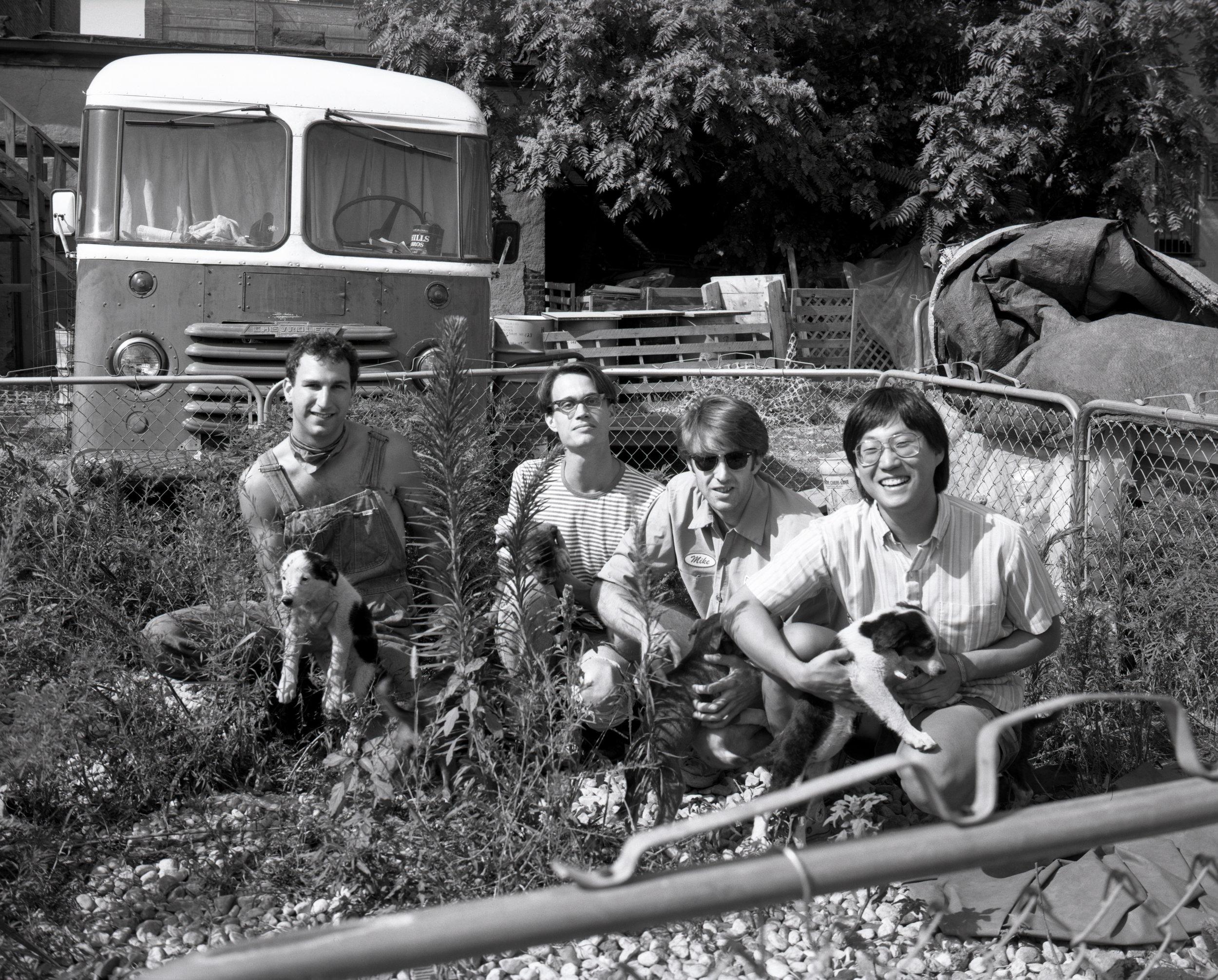 img051 Lilacs in junkyard with puppies on Maxwell Street Fall 1991.jpg
