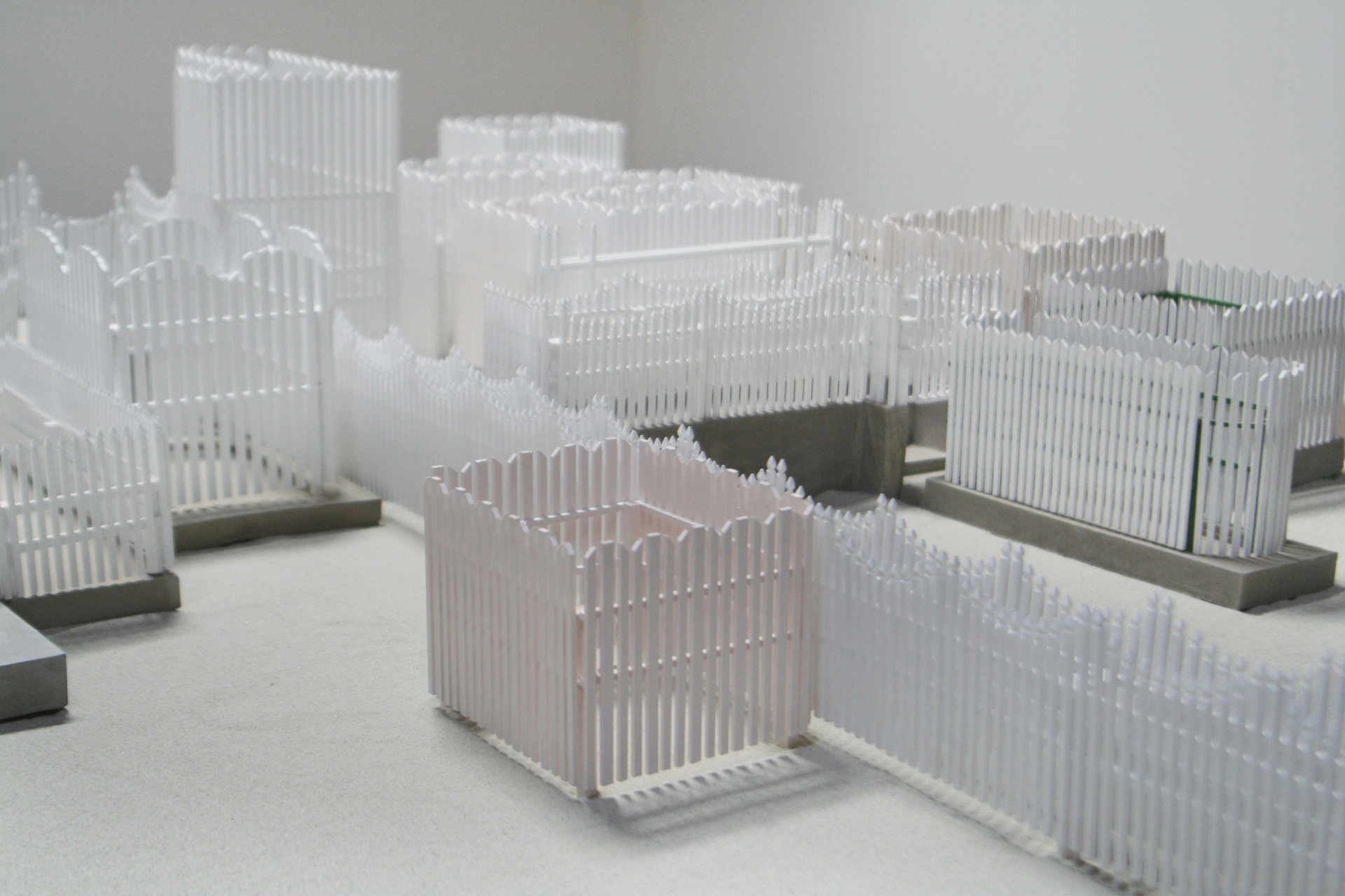 Installation view (detail),  Fence,  8 x 8 feet, wood, acrylic, cement, and sand