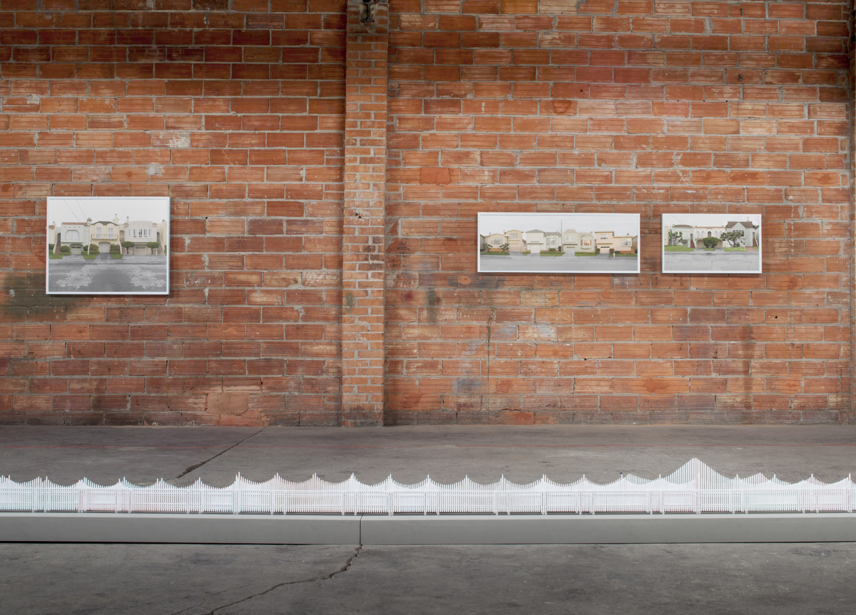 Installation view,  Fence  sculptural installation with  Streets  photographs,  Trace  exhibition at SCA Contemporary, Albuquerque, NM, 2014. Image courtesy of Andy Mattern.