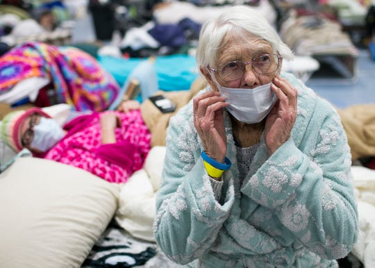 85-year-old Minna Anderson, right, sits on a bed next to her daughter Libby Andersen, left, at the East Avenue Church Shelter in Chico, California, on Nov. 15, 2018. The two lost everything when the Camp Fire took over their home in Paradise, forcing them to flee. (Photo: Thomas Hawthorne/USA TODAY NETWORK)