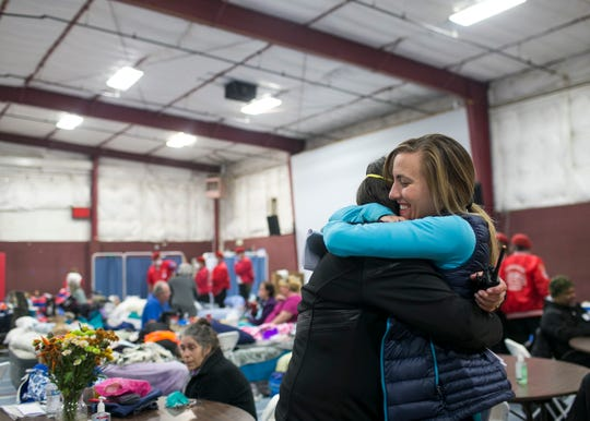 ER nurse Birgitte Randall, right, hugs a volunteer at the East Avenue Church Shelter in Chico, California, on Nov. 17, 2018. Randall fled her burning hospital Feather River in Paradise as the Camp Fire raged through town, eventually destroying her home. Responding to a Facebook request for help at the East Avenue Shelter, Randall and several of her colleagues and friends quickly sprung to action, starting a pop-up clinic at the shelter to aid evacuees in need of medical attention. (Photo: Thomas Hawthorne/USA TODAY NETWORK)