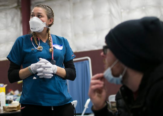 Nurse Holly Mentzel, left, volunteers with Camp Fire evacuees at the East Avenue Church Shelter in Chico, California, on Nov. 16, 2018.  (Photo: Thomas Hawthorne/USA TODAY NETWORK)