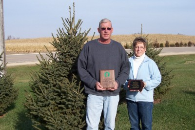 Brad and Patty Manuel from Olin, IA with their state award from the Iowa Soil and Water Districts for Best Windbreak in the state of Iowa. We planned, provided and planted the trees for this windbreak in 2001.